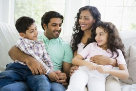 image of asian american family sitting on couch